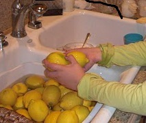 Cleaning lemons in sink